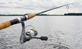 Fishing reel on rod Royalty Free Stock Photo