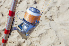 Fishing reel on rod detail with orange showy line for last line. Section, Huelva, Spain royalty free stock images
