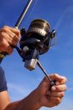 Fishing reel. Fishing scene. Close-up on fishing reel Stock Photography
