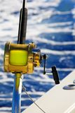 A fishing reel set against blue ocean Royalty Free Stock Images