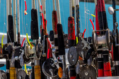 Fishing reels at the ready Stock Images