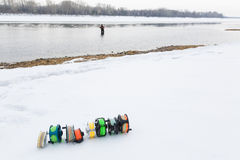 Fishing reels set close up  on white snow Royalty Free Stock Images