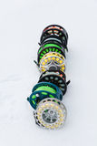 Fishing reels set close up  on white snow Stock Photography