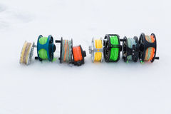 Fishing reels set close up  on white snow Stock Images