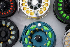 Fishing reels set close up  on white snow Royalty Free Stock Photo