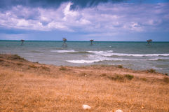 Fishing rigs in sea. Stock Photo