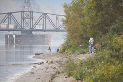Fishing by the River Stock Photography