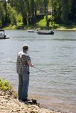 Fishing on the river. On a afternoon stock photo