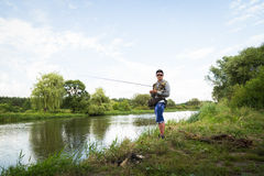 Fishing in river Stock Photography