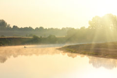 Fishing on river in fog Stock Photography