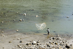 Fishing by the river. Kameng in Arunachal pradesh royalty free stock photo