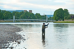 Fishing the River Ness. Fly fishing for salmon with rod and line on the River Ness Stock Photos