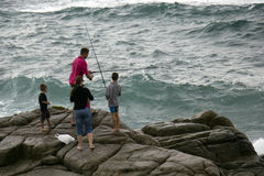 Fishing on rocks. Fishing in Margate, Natal, South-Africa  at rocks Stock Photography