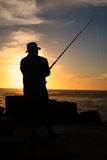 Fishing on the rocks. Royalty Free Stock Image