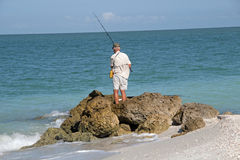 Fishing from the Rocks Royalty Free Stock Photography