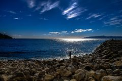 A Lonely Fisherman in the Mediterranean stock photography