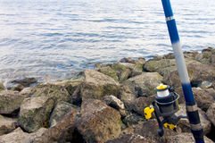 Fishing rod. Blue and white in the sea Stock Images