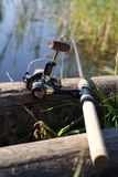 Fishing rod. Photo of fishing rod on the lake coast Stock Image