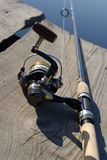 Fishing rod. Photo of fishing rod on the lake coast Royalty Free Stock Photo