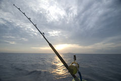 Fishing rod. Mounted on boat in sunset Royalty Free Stock Photography