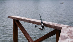 Fishing rod. The rod against the background of the lake Stock Image
