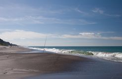 Fishing rod on beach royalty free stock photos