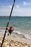 Fishing rod on a beach Stock Photos