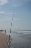 Fishing rod on the beach Royalty Free Stock Photos