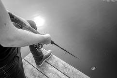 Fishing rod black white. Man fishing Royalty Free Stock Photo