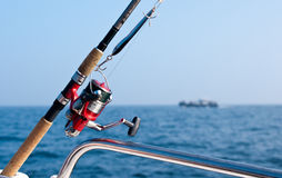 Fishing rod on boat at sea Stock Image