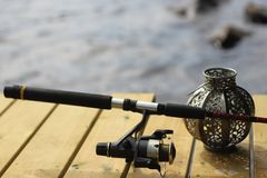 Fishing rod on a bridge royalty free stock image