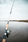 Fishing rod. At the calm autumn river Royalty Free Stock Photo