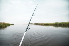 Fishing rod. At the calm autumn river Royalty Free Stock Image