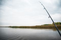 Fishing rod. At the calm autumn river Royalty Free Stock Photography