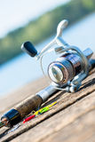 Fishing rod on close to lake Royalty Free Stock Photo