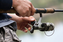 Fishing rod. A close-up of a fishing rod in a man's hand stock photos