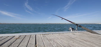 Fishing rod in dock Royalty Free Stock Photos