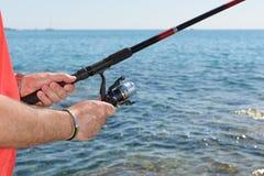 Fishing Rod and Fisherman Stock Photos
