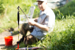Fishing rod with float close up Stock Photos
