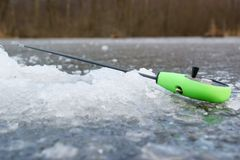 Fishing rod on frozen lake Stock Photography
