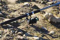 Fishing rod on the ground Stock Photo