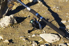 Fishing rod on the ground Stock Images