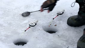 Fishing rod. Ice fishing, fishing from the hole, the tackle is called the grasshopper hook mormyshka stock video