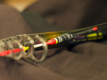 Fishing rod with inertialess reel and float close-up Royalty Free Stock Image
