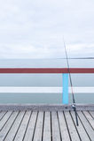Fishing rod on jetty Royalty Free Stock Photos