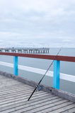 Fishing rod on jetty Stock Photos