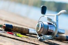 Fishing rod on jetty close Royalty Free Stock Image
