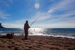 Fishing rod lake fisherman men sport summer lure sunset water outdoor sunrise fish - stock image. stock images