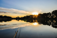 Fishing rod on the lake in sunset evening time. Nature Landscape Stock Photos