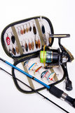 Fishing rod and lures with bag for baits on white. Royalty Free Stock Photography